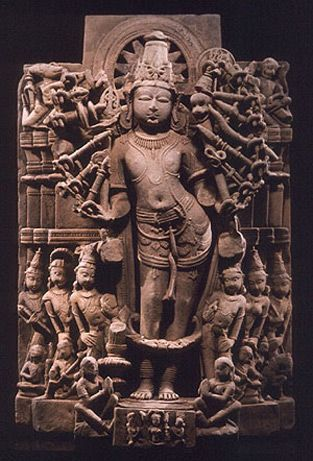 Cosmic Form of Eighteen-Armed Vishnu India. 11th century Sandstone 2001.1.4 Ester R This highly unusual form of Vishnu in cosmic manifestation shows his supremacy through delicate architectural relief. Like the Durga sculpture, he stands in the three-fold (tribhanga) pose of gracefulness, with two worshippers in the honorific (namaskara) pose at his feet.