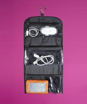 Hanging Wash Bag as Cord Storage - Store chargers, power cords, and extra headphones in the clear pouches of a hanging jewelry organizer. You'll be able to find exactly what you're looking for and packing your tech is that much easier.
