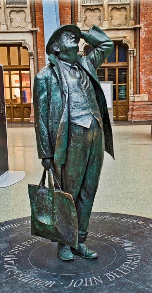 """Sir John Betjeman was British Poet Laureate from 1972 to 1984. A lover of Victorian architecture he campaigned vigorously in the 1960s against the proposed demolition of St. Pancras station. Beneath him reads """"John Betjeman 1906-1984, poet, who saved this glorious station"""" :D http://en.wikipedia.org/wiki/John_Betjeman"""