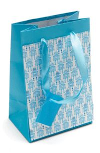 Pack party favours in themed gift bags.