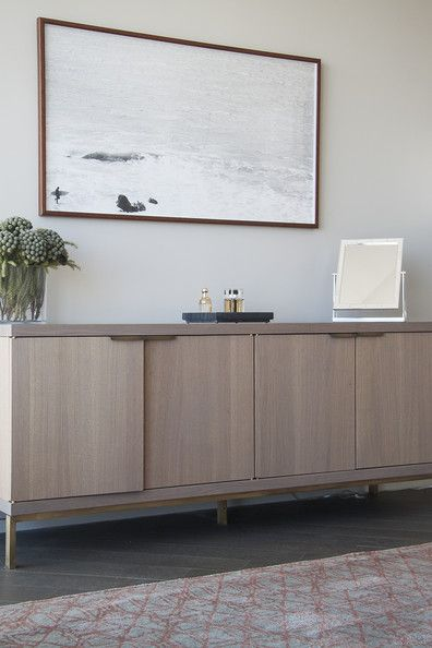 Bare All This minimal console is the ideal complement to the large scale surf portrait above it.