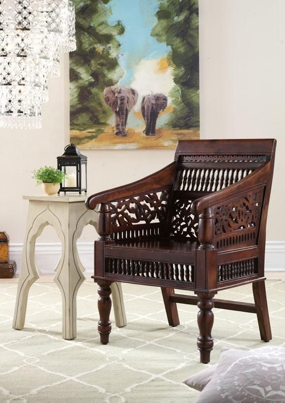 Our hand-carved Maharaja Chair adds a touch of global influence to any space. HomeDecorators.com
