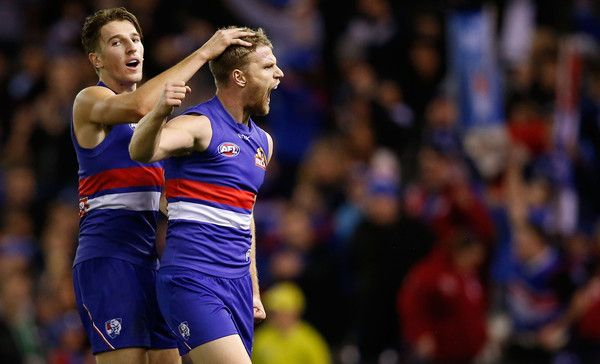 Jake Stringer and Marcus Bontempelli Photos - Marcus Bontempelli (left) congratulates teammate Jake Stringer of the Bulldogs  on a goal during the 2015 AFL round 14 match between the Western Bulldogs and the Carlton Blues at Etihad Stadium, Melbourne, Australia on July 4, 2015. - AFL Rd 14 - Western Bulldogs v Carlton