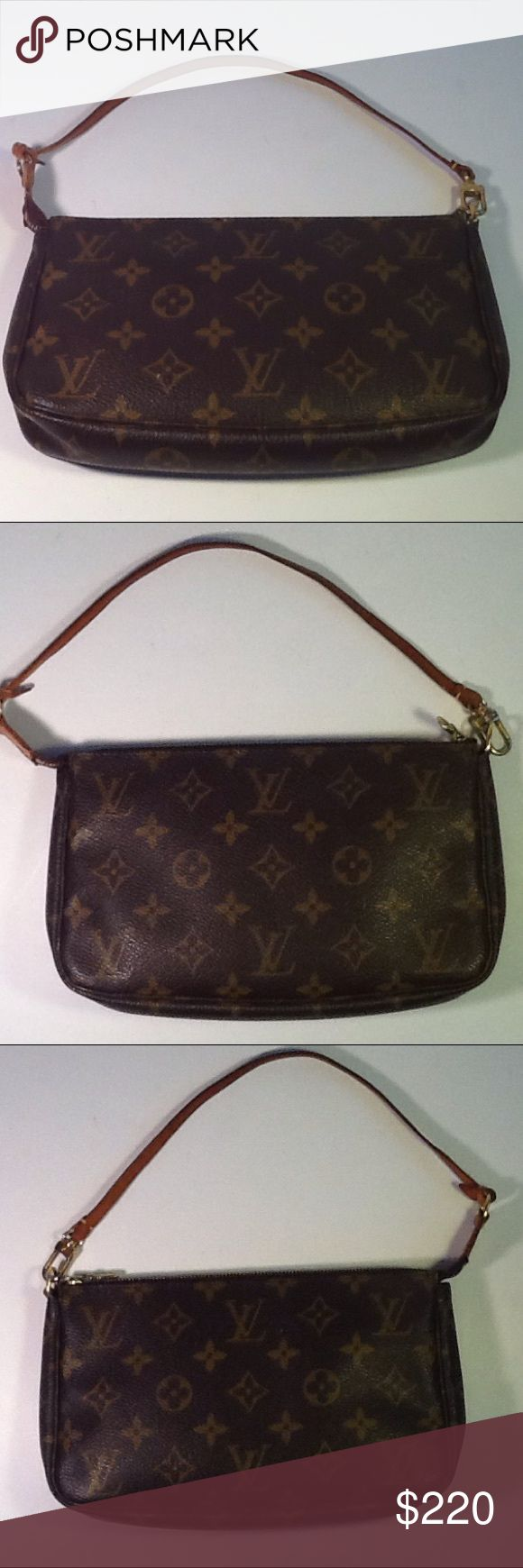 Authentic Louis Vuitton Monogram Pochette Hanbag. The strap showed signs of used. The canvas and inside linen are good. The bag was made in France with a date code VI 1020. Louis Vuitton Bags Clutches & Wristlets