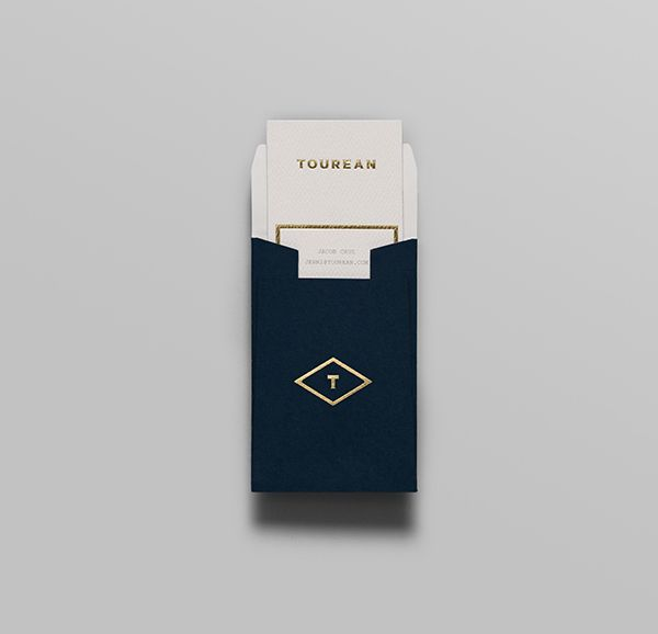 Logotype and business card with gold foil detail for British multinational venture capital firm Tourean designed by Anagrama.
