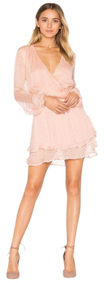 Free People Daliah Mini M Dusty Pink Dress. Free shipping and guaranteed authenticity on Free People Daliah Mini M Dusty Pink DressFeminine mini dress in blouson silhouette Surplice...