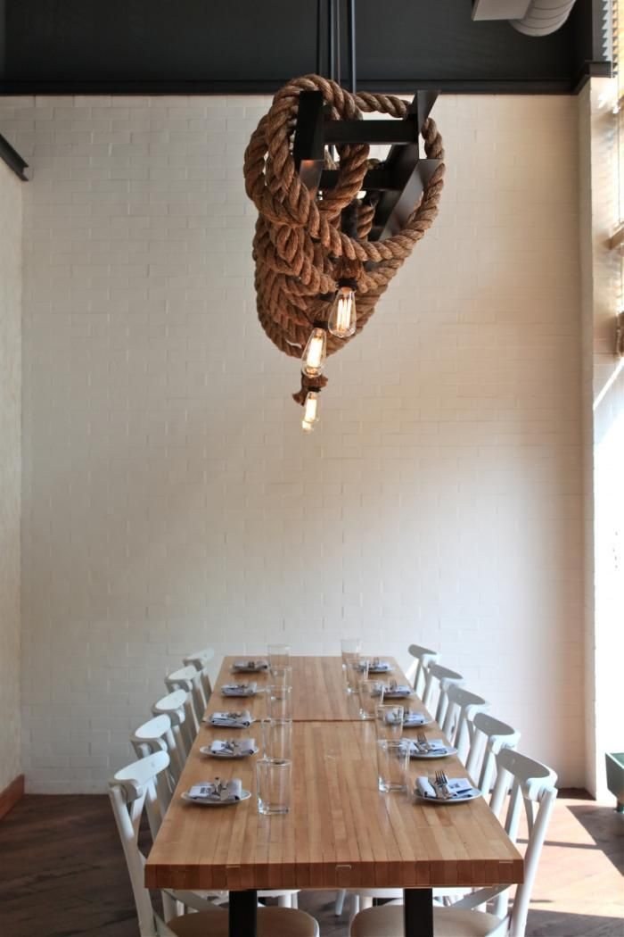 great industrial lighting design. I've thought a lot about mixing the natural materials of rope and wood, but this metal and rope is really great too.