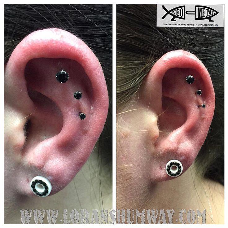 Triple cartilage piercing project done with @neometaljewelry #skindeepolean #loranshumway (at Skin Deep Tattoo & Piercing)