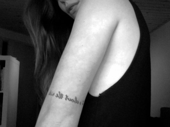 """It's about the ride"" right above the elbow. It reminds me not to focus on the past nor the future but the ride in between. Basically, it's just a cooler version of Carpe Diem."