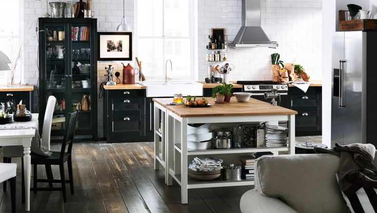 Back to back kitchen islands and a glass door cabinet in an open spaced kitchen for standing table in studio