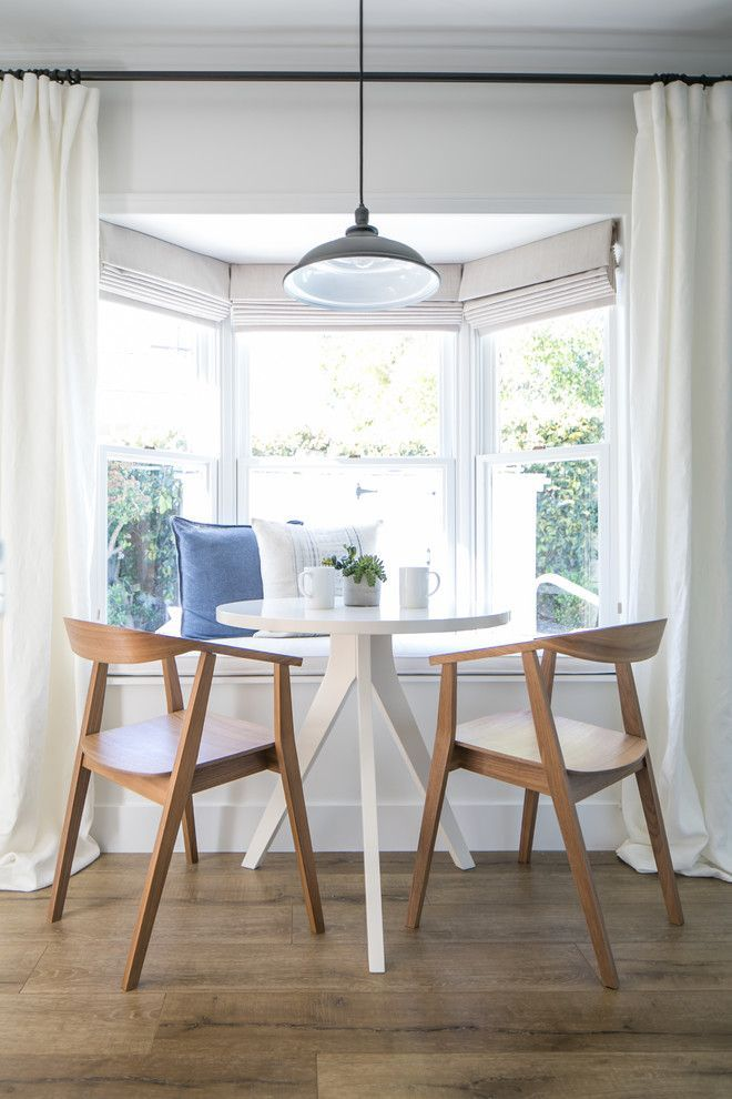 Nook Bistro for a Farmhouse Dining Room with a Mid Century Modern Chairs and Modern Farmhouse by Lindye Galloway Design