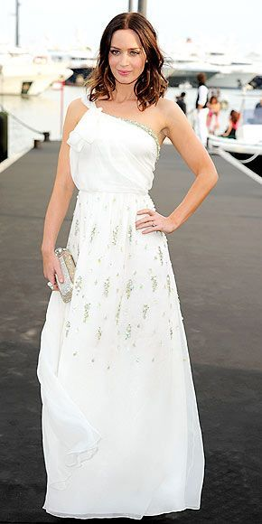 Is she practicing for her wedding? Arriving without fiancé John Krasinski, the British actress is a vision in her sweeping white gown at the Giorgio Armani bash.
