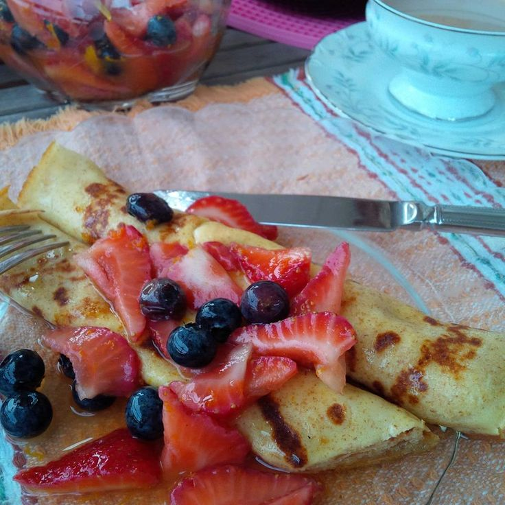 Breakfast food for dinner is a real treat! Here are French crêpes stuffed with cream cheese, topped with blueberry & strawberry salad with cardamom & vanilla, orange zest & juice and maple syrup + a pot of tea!