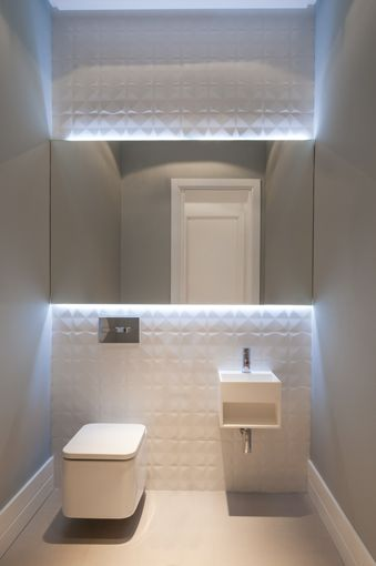 White bathrooms are always going to be popular - make yours stand out with some subtle LED mood lighting.