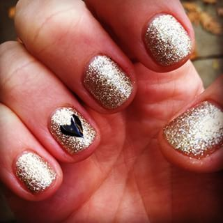 Classy New Year's nail art, anyone? | 24 Delightfully Festive Ways To Do Your Nails For The Holidays