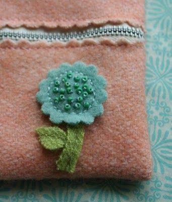 Felt zippered pouch The tutorial is here:  http://theadventuresofbluegirlxo.blogspot.com/2010/04/artful-thursdays-14zipper-purse.html