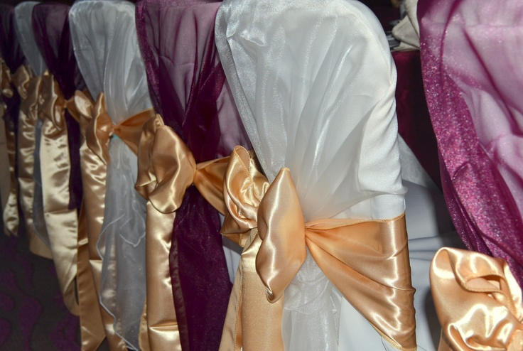 Alternating Ivory and Burgundy Organza Shawls with Gold Satin Bows on White Chair Covers