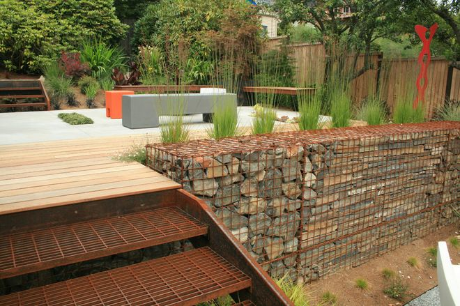 Here stone filled gabions have been used to create an Gabion wall design
