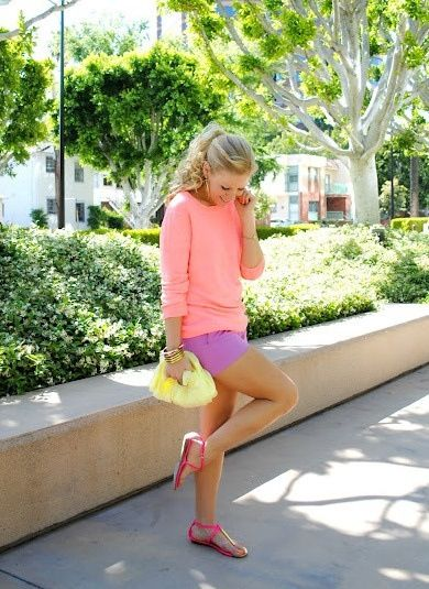 Purple shorts pink sweater yellow clutch pink sandals