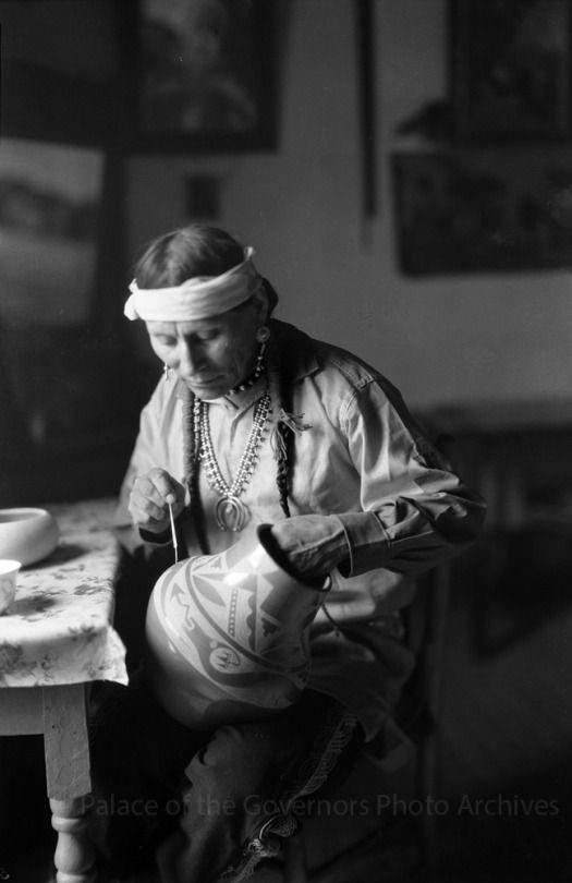 Potter Julian Martinez at work, San Ildefonso Pueblo, New Mexico  Photographer: T. Harmon Parkhurst Date: 1925 - 1945? Negative Number 055204