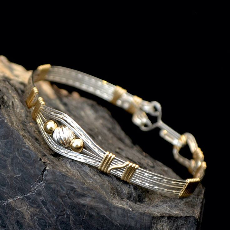 "Sterling silver and 14K gold filled wire wrapped bracelet. ""Ru la la"" by Untwistedsister on Etsy https://www.etsy.com/listing/122667627/sterling-silver-and-14k-gold-filled-wire"