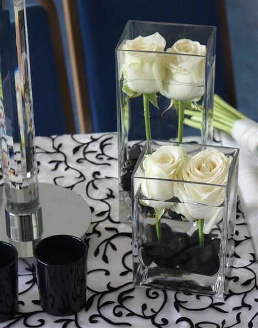 Varying height, black and white, roses.    Dinner party centerpieces
