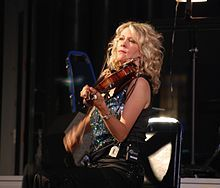 Natalie MacMaster, CM (born June 13, 1972) is an award-winning fiddler from the rural community of Troy in Inverness County, Nova Scotia, Canada who plays Cape Breton fiddle music.  MacMaster has toured with the Chieftains, Faith Hill, Carlos Santana and Alison Krauss, and has recorded with Yo-Yo Ma. She has appeared at the Celtic Colours festival in Cape Breton, Celtic Connections in Scotland, and MerleFest in the United States.
