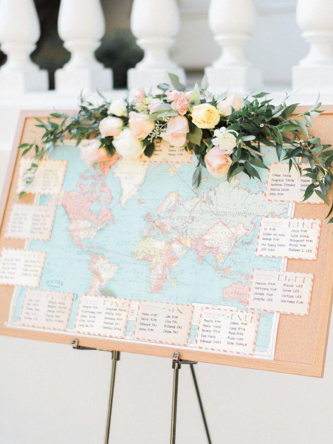 Travel-inspired map escort card display: http://www.stylemepretty.com/california-weddings/pasadena/2016/03/31/from-a-long-distance-romance-to-a-dreamy-pasadena-garden-wedding/ | Photography: Honey Honey - http://www.hoooney.com/