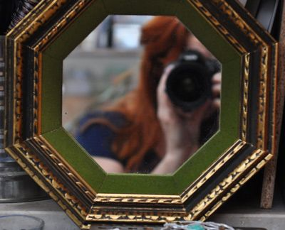 Esther in the mirror.  Who is looking at whom?