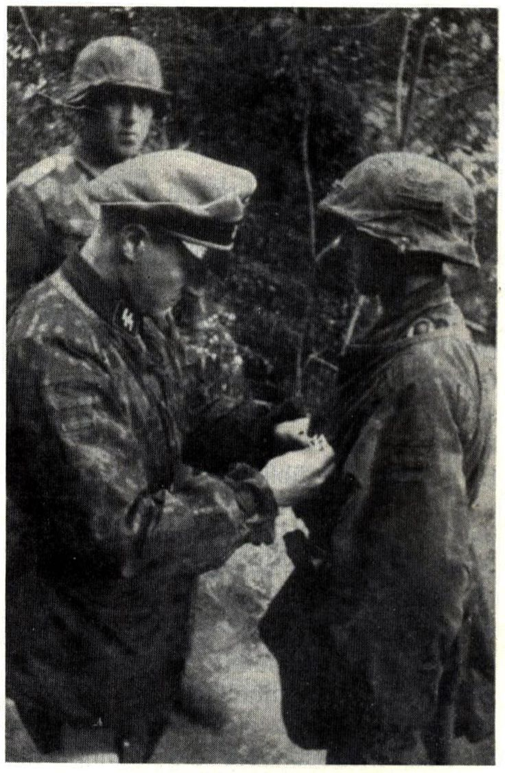 A young Waffen-SS grenadier of the 12th SS-Hitlerjugend is awarded the Iron Cross 1st Class for bravery by his commanding officer. Despite their resistance the Waffen-SS could not turn the tide in France and their victories were short lived and localized.