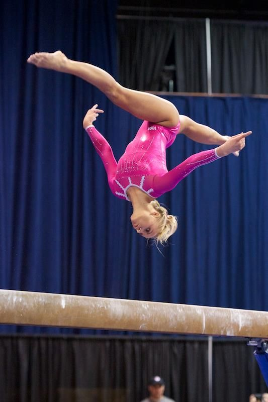 Nastia Liukin in flight gymnastics champion dancing with the stars pink balance beam suspended thin air