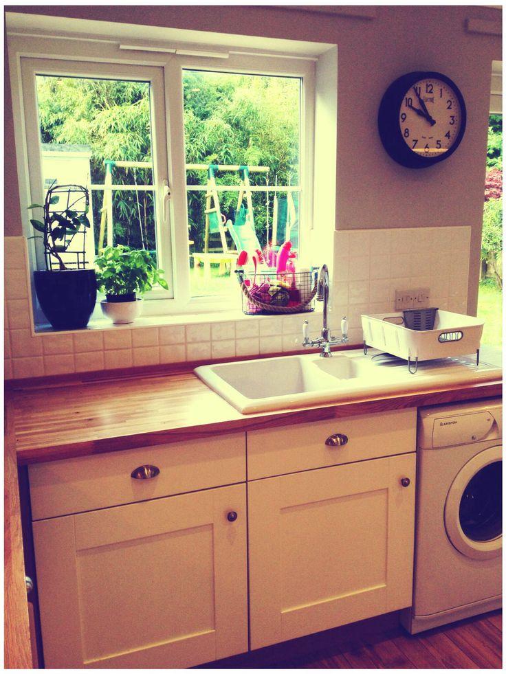 Modern Belfast sink, solid oak work tops and painted solid oak kitchen cupboard.