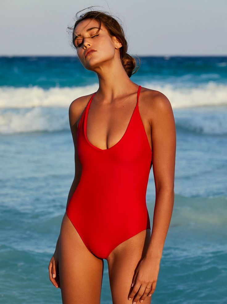 Farrah One Piece Swimsuit | American made solid one piece swimsuit featuring a plunging V-neckline. * Open strappy back * Cheeky bottom fit * High cut silhouette