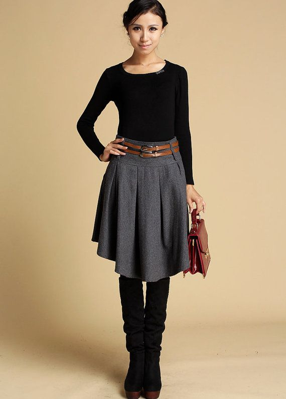 Show off you individuality with this dark gray wool mini skirt. Custom handmade from a soft wool blend, this designer mini skirt features a stylish wide