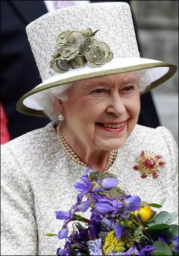 The queen is all smiles as she arrives at Trinity College in Dublin. The delicate hat made more beautiful by the floral accents, beads and net looks very fascinating.
