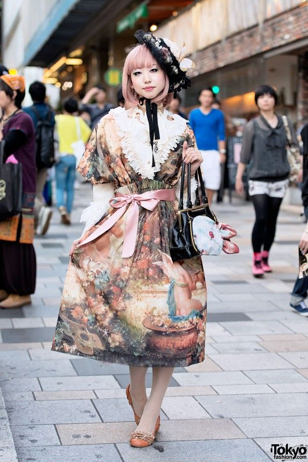 Misaki is a 20-year-old Harajuku girl who caught our eye on the street near the famous LaForet Department store. Her favorite fashion brand is the Japanese lolita label Juliette et Justine.  Misaki's beautiful print dress is by Juliette et Justine. Victorian Maiden leather purse decorated with a cute rabbit pouch from AHCAHCUM.muchacha.