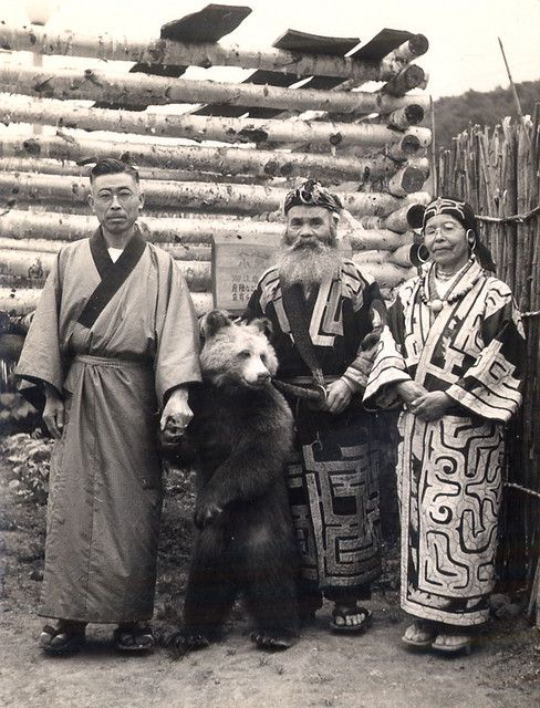 Ainu couple, a visitor from the Mainland and a bear (visitor from Russia?), Hokkaido