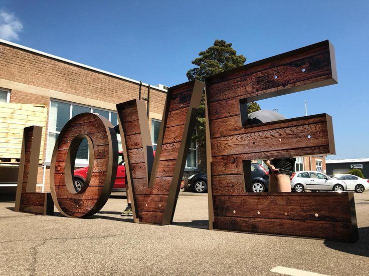 LOVE... 5ft aluminum letters, inlaid with wood effect digital print. http://www.onesignanddigital.com/signage/