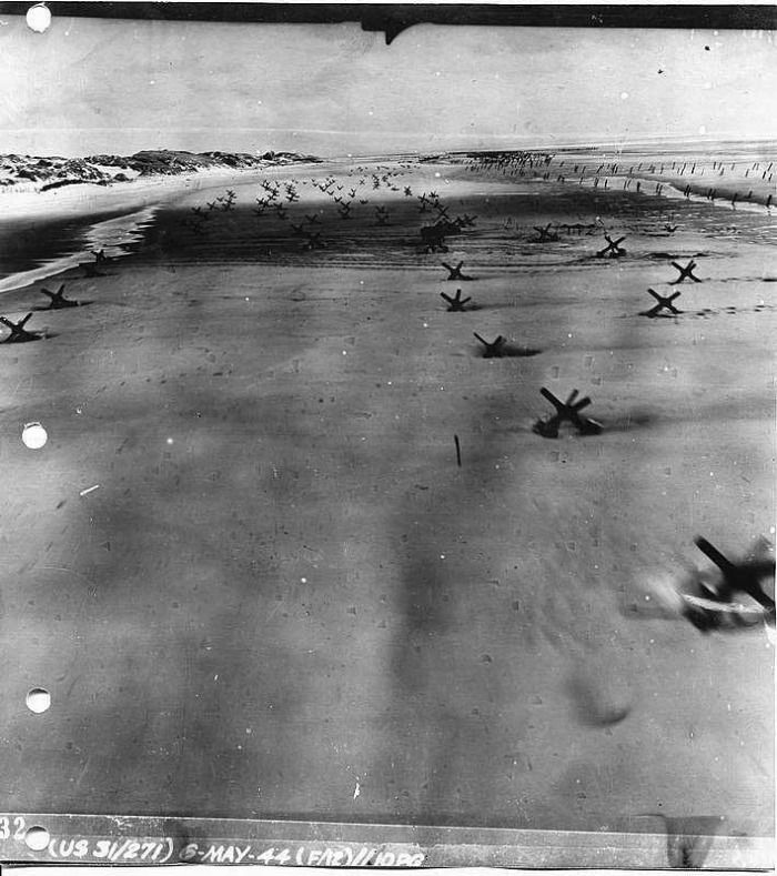 Arial view Omaha beach. Low-level Allied Reconnaissance Photo of German Beach Obstacles