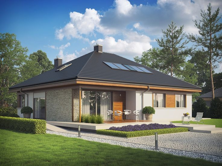 Kompaktowa bryła z eleganckim czterospadowym dachem została ubrana w piękną kompozycję elewacji.