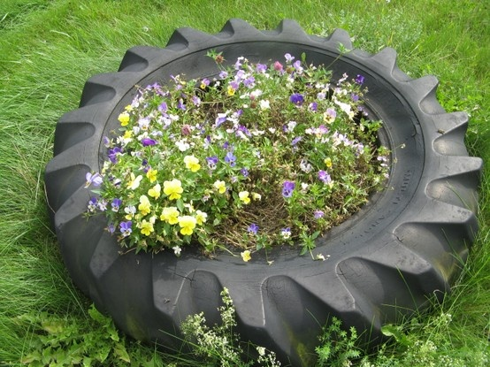 salad gardening recycled tire full of edible pansies