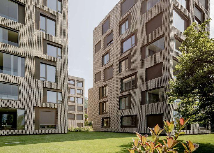 "Brick ""pixel patchwork"" envelops housing by Buzzi Studio Di Architettura"
