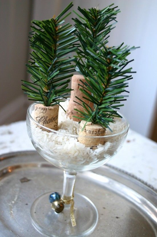New Year's Eve table decor.  Champagne or wine glass, rice, corks, and artificial greenery.