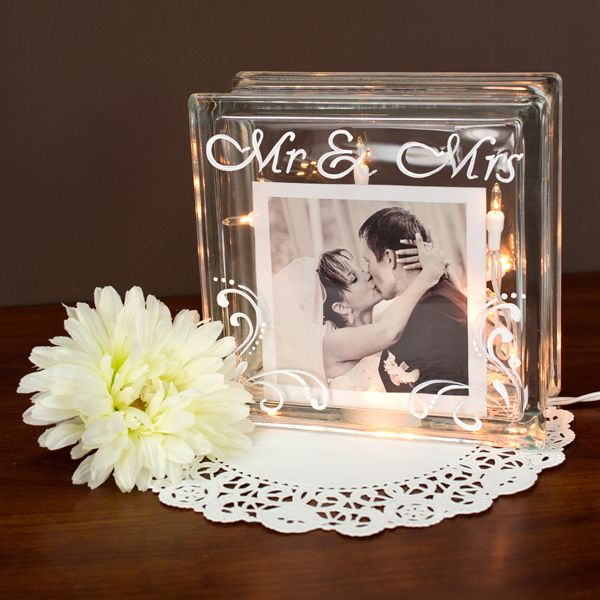 Couple of ideas for this...outer edge with burlap and bow on top, couple of sunflowers tucked into bow, lights inside -or- as shown here etched with your names and photos for table favors. These cubes are about $9.00 at Home Depot