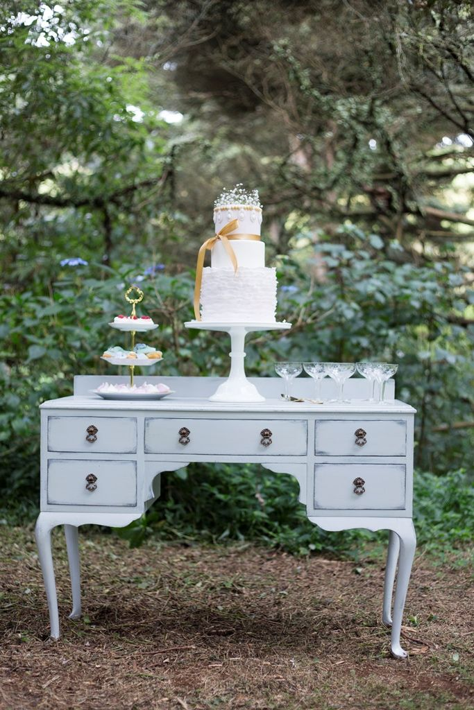 queen anne dresser and white cake stand Photography by www.facebook.com/LisaFosterPhotography  Stationery by www.facebook.com/inspiredweddings Flowers by www.facebook.com/pages/Flowers-on-Hall-Street Props by www.facebook.com/ThePrettyPropShop Gowns by www.facebook.com/girlmeetsgownpukekohe Desserts by www.facebook.com/LucysCakesandCatering Hair by www.facebook.com/DIOSAhair Venue www.facebook.com/HedgesEstate