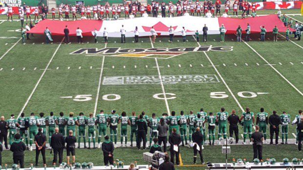 "Devin Heroux on Twitter: ""Sask. Roughriders stand arm-in-arm during O Canada at Mosaic Stadium: https://t.co/9pAEl8l3PQ #CFL https://t.co/bLo16NRxNu"""