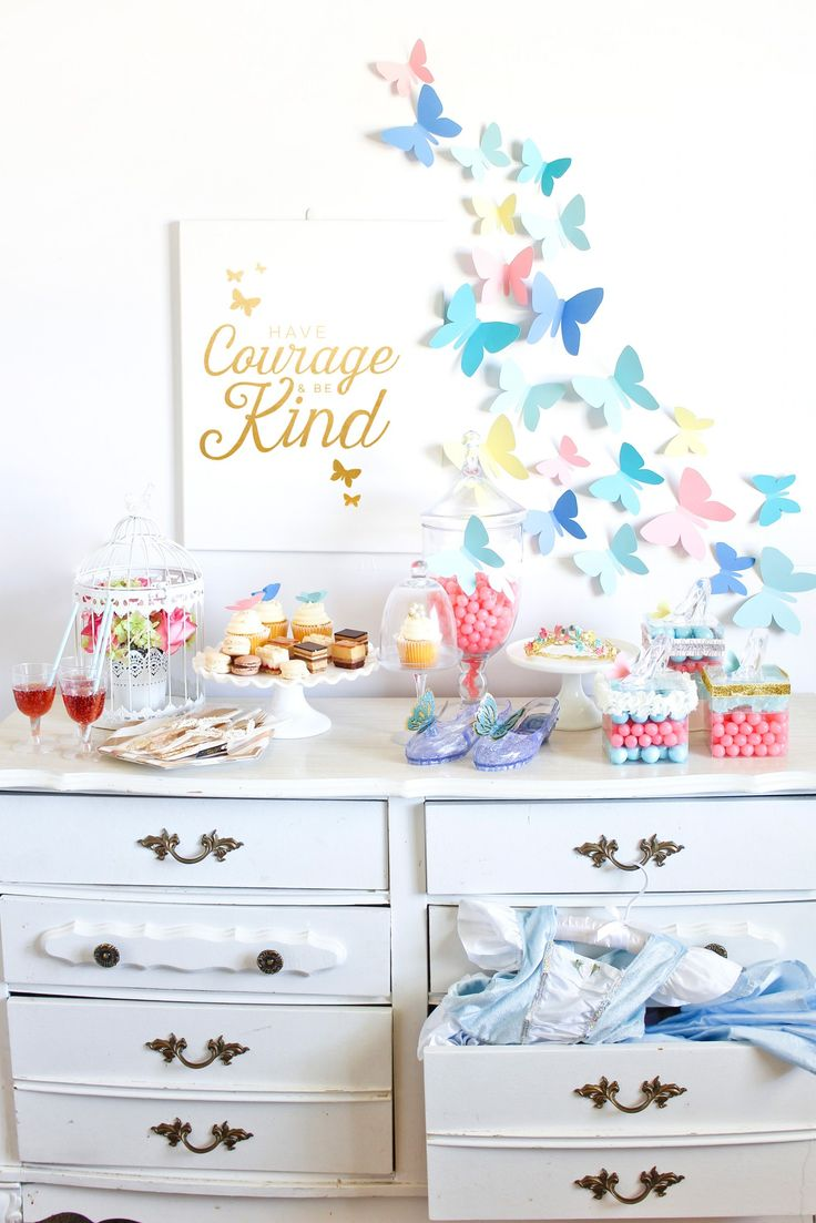 A perfect way to celebrate the kindness and courage of your little one, have a Cinderella Ball! There are plenty of desserts and treats to enjoy while watching the movie. Simple paper butterflies make up the backdrop, and we filled the dresser with dress ups for all our little guests.
