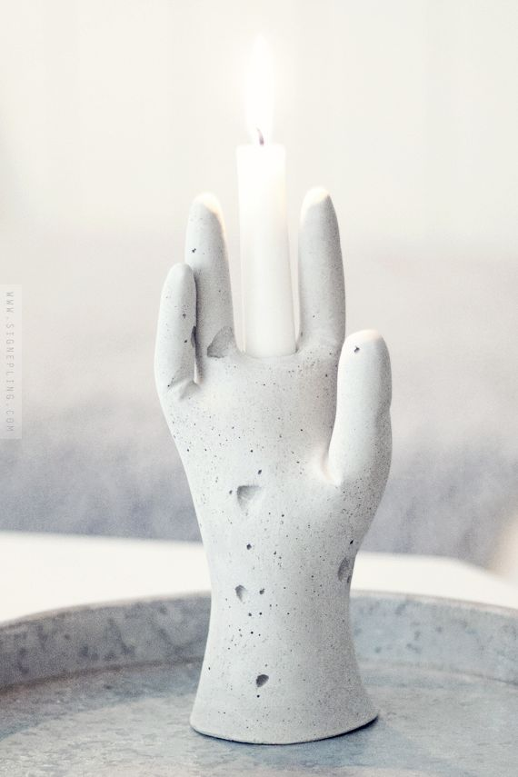 Cool DIY idea made with a rubber glove and concrete!