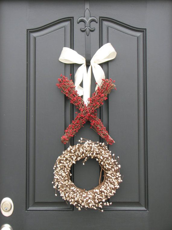 You don't need an over-the-top wreath stuffed to the brim with red and pink flowers to bring the V-day spirit to your front door. This subtle X and O wreath does the trick just fine without any overly romantic kitsch.