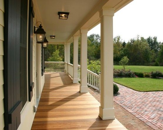 Love this porch wrapping around the house..and the shutters, the light fixtures, and clean architecture.